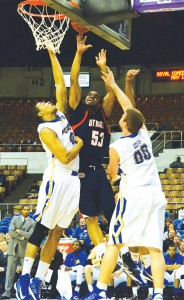 Jeremy Washington goes up for a basket as two of Morehead's players try to quell his mission in advancing in the OVC Tournament. (Tonya Evans)