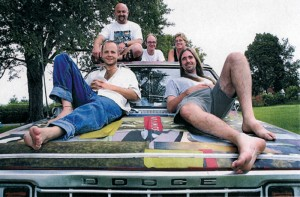 The band 27bstroke6 relaxing on the band's Dodge truck in 2000. Featured on the back row from left to right is Jay McCutheon who plays drums; Andy Wilhite who plays guitar and organ; and Dr. Julie Hill who plays percussion. Featured on the front row from left to right is Micah Barnes who plays bass and sings lead vocals; and Matt Adams who plays guitar. (Julie Hill)