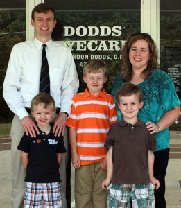 The Dodds Family is gathered in front of Dodds EyeCare in Newbern, Tenn. Pictured from left to right is UTM alumnus Dr. Brandon Dodds, Cole Dodds, UTM alumna April Baker Dodds and pictured in the front from left to right, Bo Dodds and Clay Dodds. (Sheila Scott)