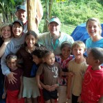 During the family mission trip, the Honduran children enjoy hanging out and playing with Lilly and James at the base camp. (Amy Burcham)