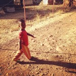A child walking in the refugee camp. (Amy Burcham)
