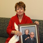 UTM alumna Betty Smith of Union City, Col. Tom's niece, is holding a photo of her uncle Col. Tom Elam and Ms. Kathleen Elam. Smith is wearing the same ring and bracelet that Ms. Kathleen is wearing in the photo. (Sheila Scott)