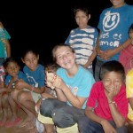 Lilly passes out Beanie Babies to the Honduran children. (Amy Burcham)