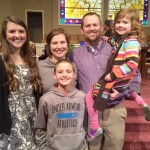 Brian and Amy Burcham pose for a family photo with their three children: Lilly, James, and Annie. (Amy Burcham)