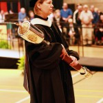 Professor Nell S. Gullett is the Processional Mace Bearer at the Spring 2014 Graduate Commencement Ceremony. (John Sellers)