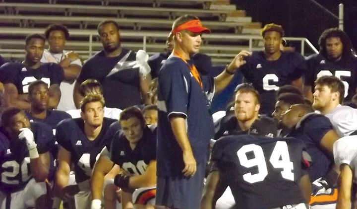 Coach Simpson instructs his team after the scrimmage. (Jared Peckenpaugh)